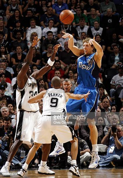 Dirk Nowitzki of the Dallas Mavericks passes against Antonio McDyess and Tony Parker of the San Antonio Spurs in Game Four of the Western Conference...