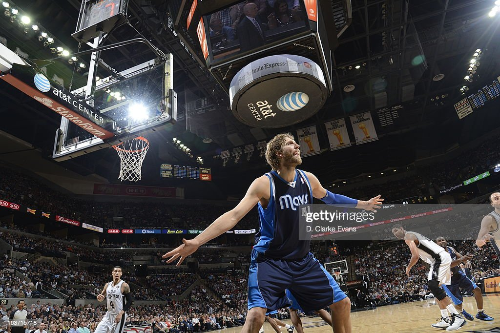 Dirk Nowitzki #41 of the Dallas Mavericks plays tight defense against the San Antonio Spurs on March 14, 2013 at the AT&T Center in San Antonio, Texas.