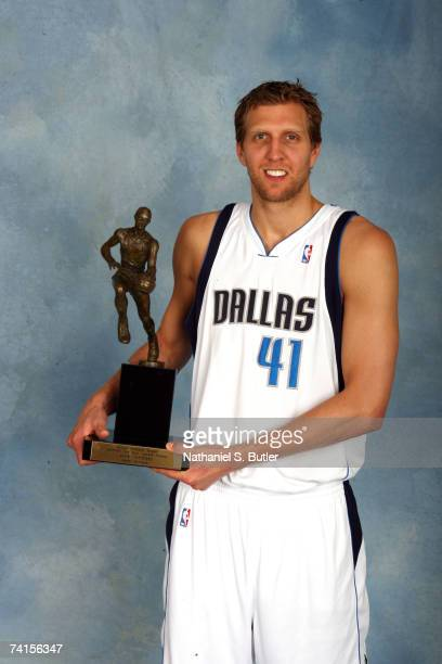 Dirk Nowitzki of the Dallas Mavericks poses for a portrait with the Maurice Podoloff 20062007 NBA MVP Trophy during the award presentation on May 15...
