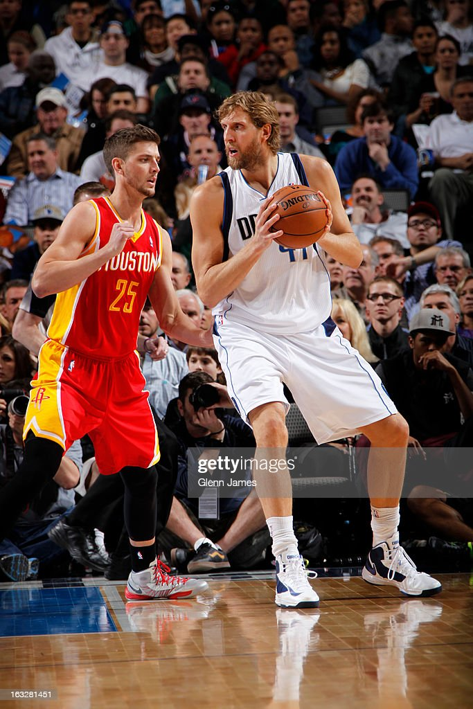Dirk Nowitzki #41 of the Dallas Mavericks posts up against Chandler Parsons #25 of the Houston Rockets on March 6, 2013 at the American Airlines Center in Dallas, Texas.