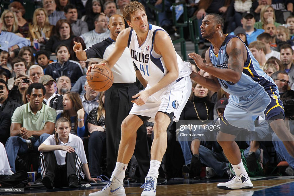 Dirk Nowitzki #41 of the Dallas Mavericks posts up against Darrell Arthur #00 of the Memphis Grizzlies on January 12, 2013 at the American Airlines Center in Dallas, Texas.