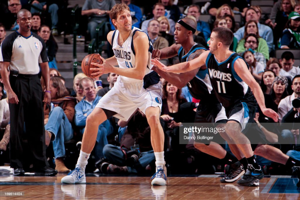 Dirk Nowitzki #41 of the Dallas Mavericks posts up against J.J. Barea #11 and Dante Cunningham #33 of the Minnesota Timberwolves on January 14, 2013 at the American Airlines Center in Dallas, Texas.