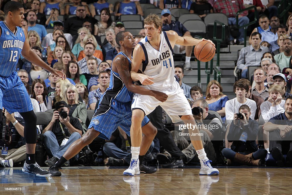 Dirk Nowitzki of the Dallas Mavericks posts up against Kris Joseph of the Orlando Magic on October 14 2013 at the American Airlines Center in Dallas...