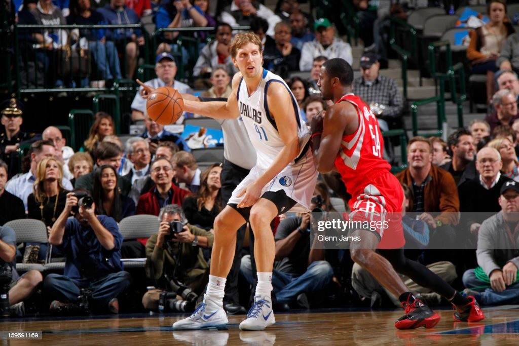 Dirk Nowitzki #41 of the Dallas Mavericks posts up against Patrick Patterson #54 of the Houston Rockets on January 16, 2013 at the American Airlines Center in Dallas, Texas.