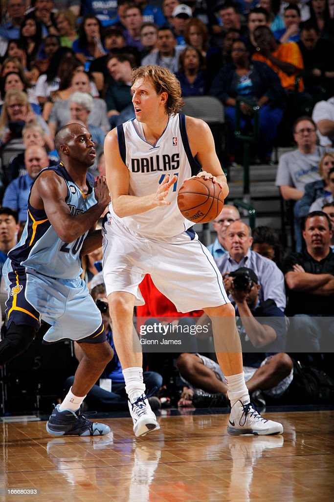 Dirk Nowitzki #41 of the Dallas Mavericks posts up against Quincy Pondexter #20 of the Memphis Grizzlies on April 15, 2013 at the American Airlines Center in Dallas, Texas.