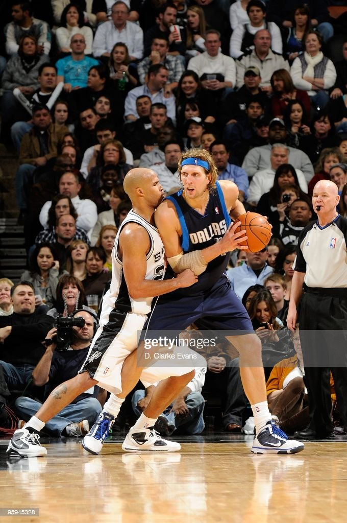 Dirk Nowitzki #41 of the Dallas Mavericks posts up against Richard Jefferson #24 of the San Antonio Spurs during the game on January 8, 2010 at the AT&T Center in San Antonio, Texas. The Mavericks won 112-103.