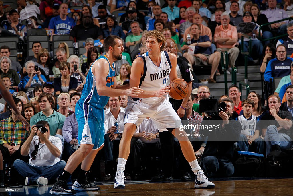Dirk Nowitzki #41 of the Dallas Mavericks posts up against Ryan Anderson #33 of the New Orleans Hornets on April 17, 2013 at the American Airlines Center in Dallas, Texas.