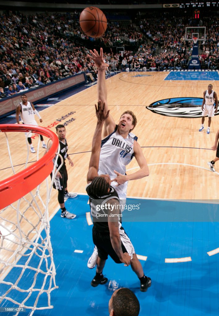 Dirk Nowitzki #41 of the Dallas Mavericks puts up a shot against the San Antonio Spurs on December 30, 2012 at the American Airlines Center in Dallas, Texas.