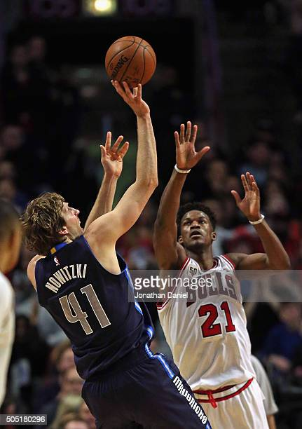 Dirk Nowitzki of the Dallas Mavericks puts up a shot over Jimmy Butler of the Chicago Bulls on his way to a gamehigh 21 points at the United Center...