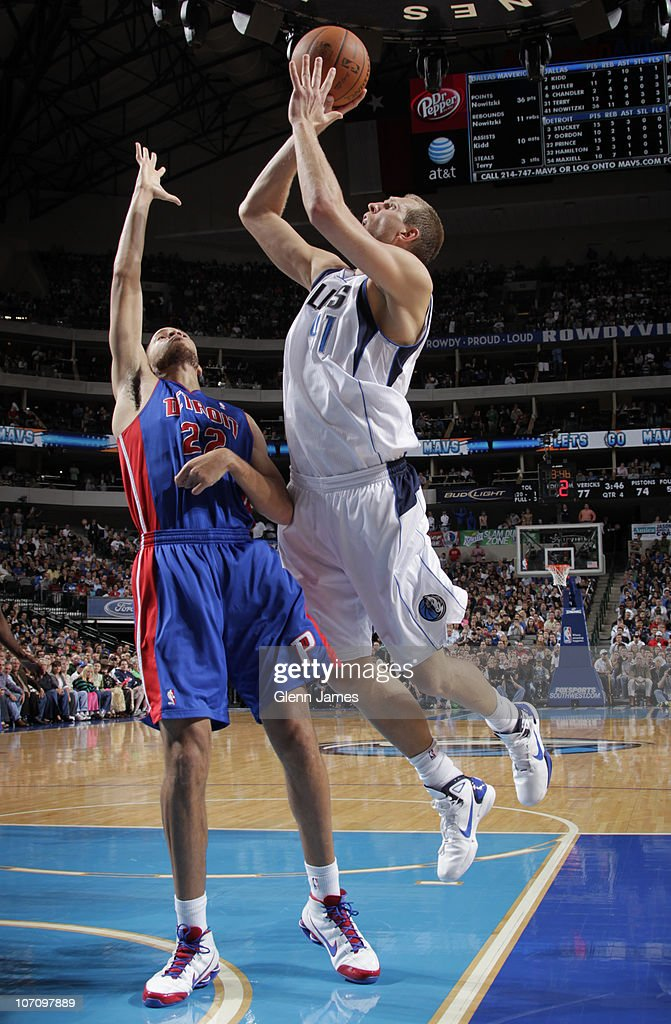<a gi-track='captionPersonalityLinkClicked' href=/galleries/search?phrase=Dirk+Nowitzki&family=editorial&specificpeople=201490 ng-click='$event.stopPropagation()'>Dirk Nowitzki</a> #41 of the Dallas Mavericks puts up the shot against <a gi-track='captionPersonalityLinkClicked' href=/galleries/search?phrase=Tayshaun+Prince&family=editorial&specificpeople=201553 ng-click='$event.stopPropagation()'>Tayshaun Prince</a> #22 of the Detroit Pistons during a game on November 23, 2010 at the American Airlines Center in Dallas, Texas.