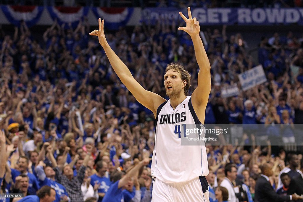 Dirk Nowitzki #41 of the Dallas Mavericks reacts after making a three-pointer in the fourth quarter while taking on the Oklahoma City Thunder in Game Five of the Western Conference Finals during the 2011 NBA Playoffs at American Airlines Center on May 25, 2011 in Dallas, Texas.