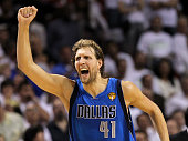 Dirk Nowitzki of the Dallas Mavericks reacts after making a threepointer in the fourth quarter while taking on the Miami Heat in Game Six of the 2011...