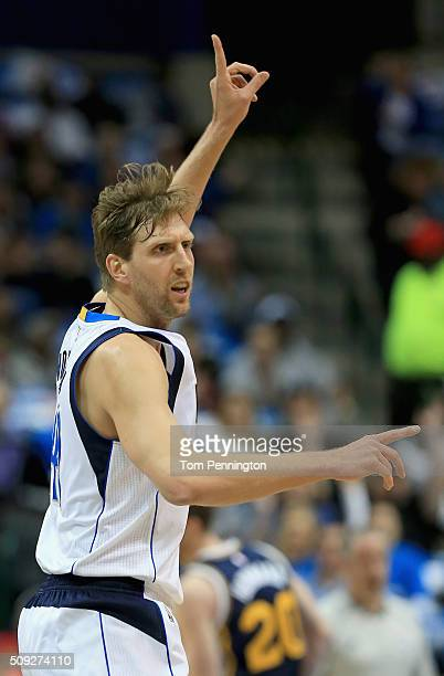 Dirk Nowitzki of the Dallas Mavericks reacts after making a threepoint shot against the Utah Jazz in the first quarter at American Airlines Center on...