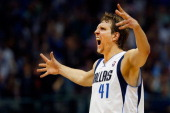 Dirk Nowitzki of the Dallas Mavericks reacts after making a three point shot against the Phoenix Suns in the third quarter at American Airlines...