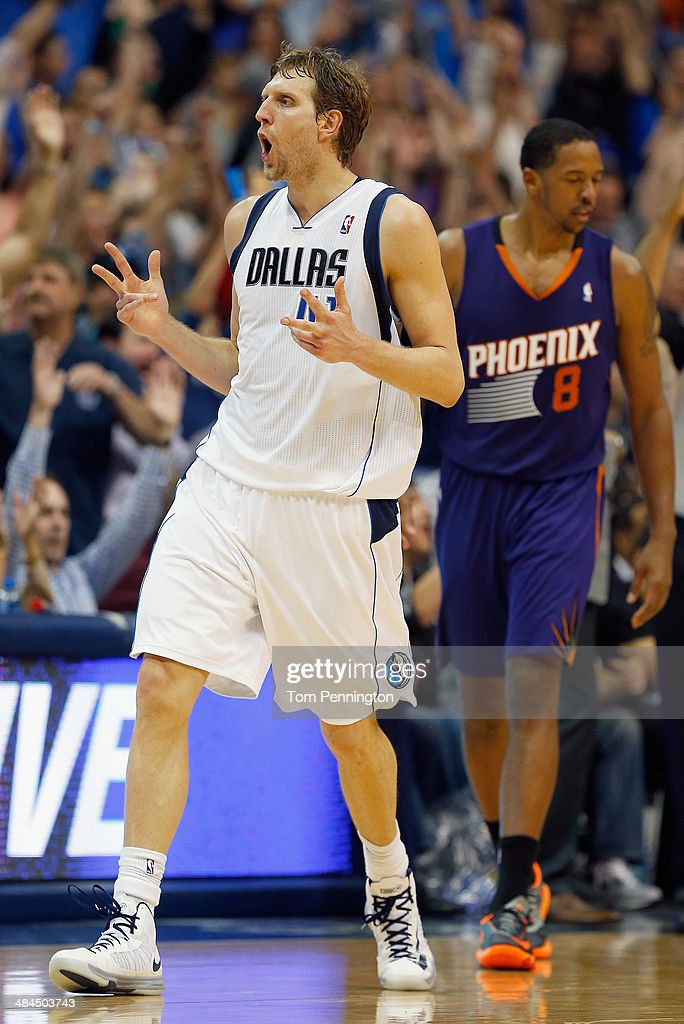 <a gi-track='captionPersonalityLinkClicked' href=/galleries/search?phrase=Dirk+Nowitzki&family=editorial&specificpeople=201490 ng-click='$event.stopPropagation()'>Dirk Nowitzki</a> #41 of the Dallas Mavericks reacts after making a three point shot against the Phoenix Suns at American Airlines Center on April 12, 2014 in Dallas, Texas.