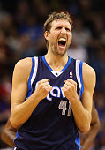 Dirk Nowitzki of the Dallas Mavericks reacts after scoring against the Phoenix Suns during the second half of the NBA game at US Airways Center on...