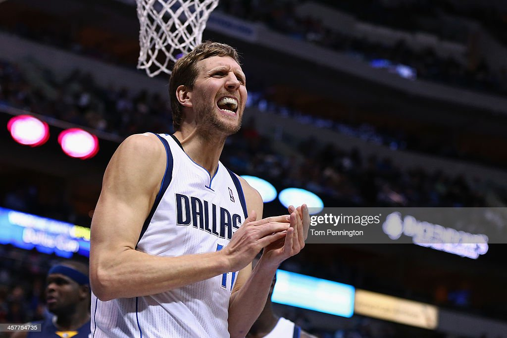 Dirk Nowitzki #41 of the Dallas Mavericks reacts against the Memphis Grizzlies at American Airlines Center on December 18, 2013 in Dallas, Texas.