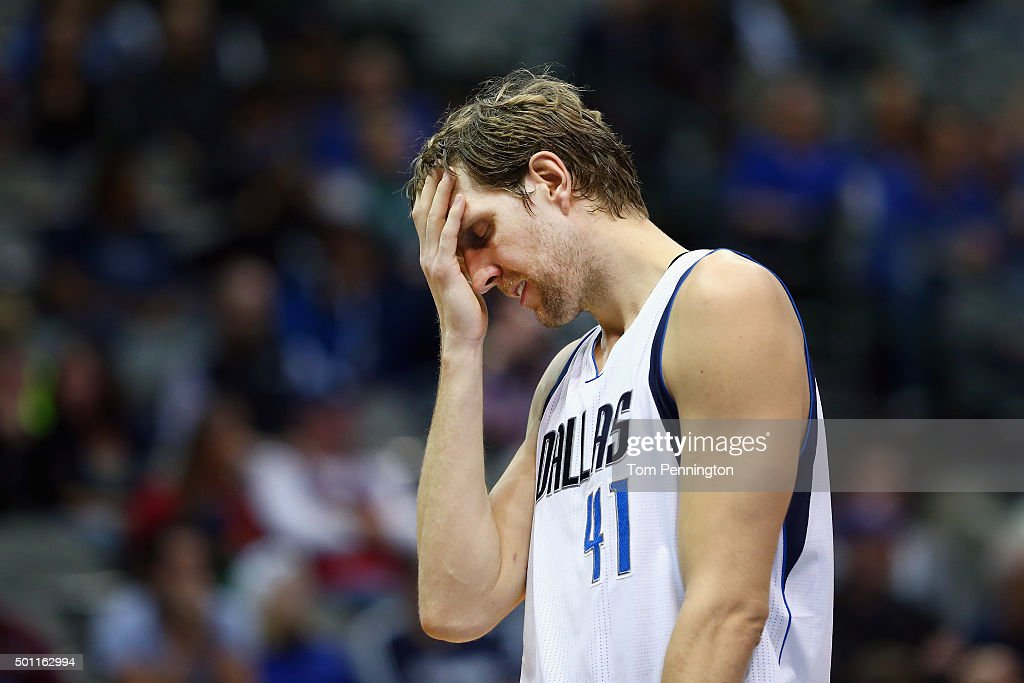 <a gi-track='captionPersonalityLinkClicked' href=/galleries/search?phrase=Dirk+Nowitzki&family=editorial&specificpeople=201490 ng-click='$event.stopPropagation()'>Dirk Nowitzki</a> #41 of the Dallas Mavericks reacts against the Washington Wizards in the fourth quarter at American Airlines Center on December 12, 2015 in Dallas, Texas. The Washington Wizards beat the Dallas Mavericks 114-111.