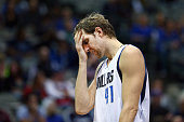 Dirk Nowitzki of the Dallas Mavericks reacts against the Washington Wizards in the fourth quarter at American Airlines Center on December 12 2015 in...