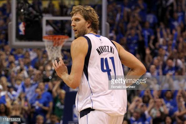 Dirk Nowitzki of the Dallas Mavericks reacts as he runs back down court against the Miami Heat in the first half of Game Five of the 2011 NBA Finals...