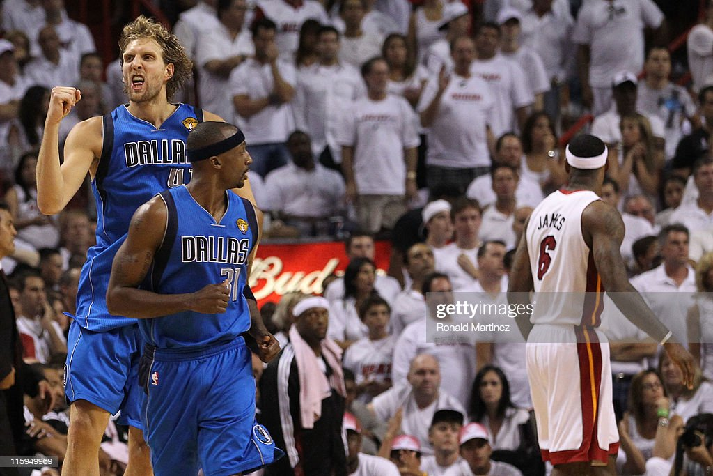 <a gi-track='captionPersonalityLinkClicked' href=/galleries/search?phrase=Dirk+Nowitzki&family=editorial&specificpeople=201490 ng-click='$event.stopPropagation()'>Dirk Nowitzki</a> #41 of the Dallas Mavericks reacts behind teammate <a gi-track='captionPersonalityLinkClicked' href=/galleries/search?phrase=Jason+Terry&family=editorial&specificpeople=201734 ng-click='$event.stopPropagation()'>Jason Terry</a> #31 after Nowitzki makes a jump shot in the fourth quarter while taking on the Miami Heat in Game Six of the 2011 NBA Finals at American Airlines Arena on June 12, 2011 in Miami, Florida.
