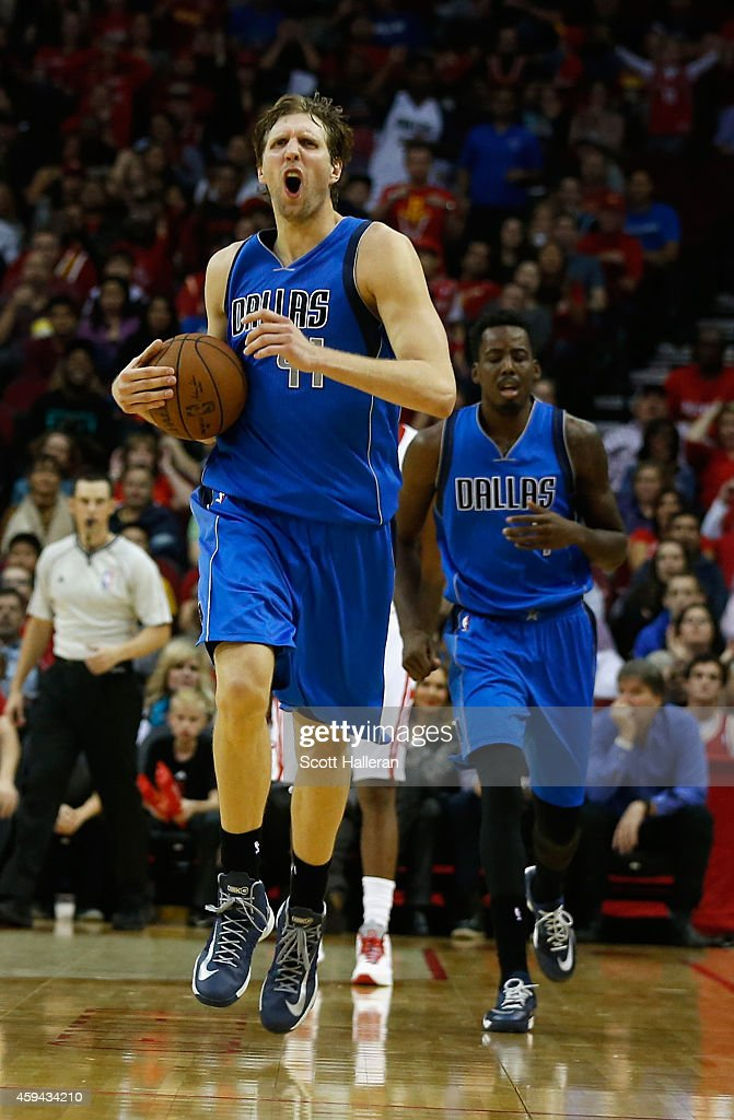 Dirk Nowitzki of the Dallas Mavericks reacts to a play on the court during their game against the Houston Rockets at the Toyota Center on November 22...