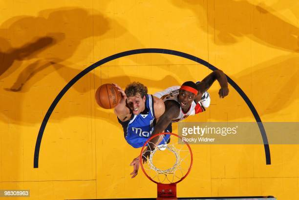 Dirk Nowitzki of the Dallas Mavericks rebounds against Anthony Morrow of the Golden State Warriors during the game at Oracle Arena on March 27 2010...