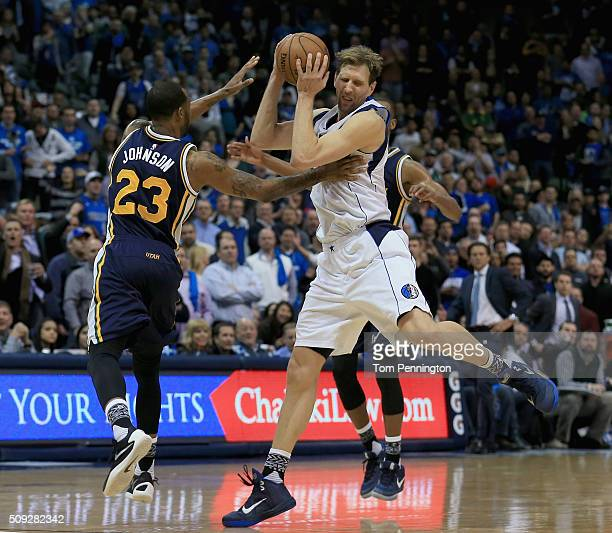 Dirk Nowitzki of the Dallas Mavericks scrambles for the ball against Chris Johnson of the Utah Jazz in overtime at American Airlines Center on...