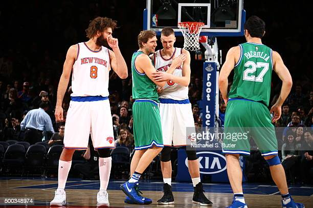 Dirk Nowitzki of the Dallas Mavericks shakes hands with Kristaps Porzingis of the New York Knicks before the game on December 7 2015 at Madison...