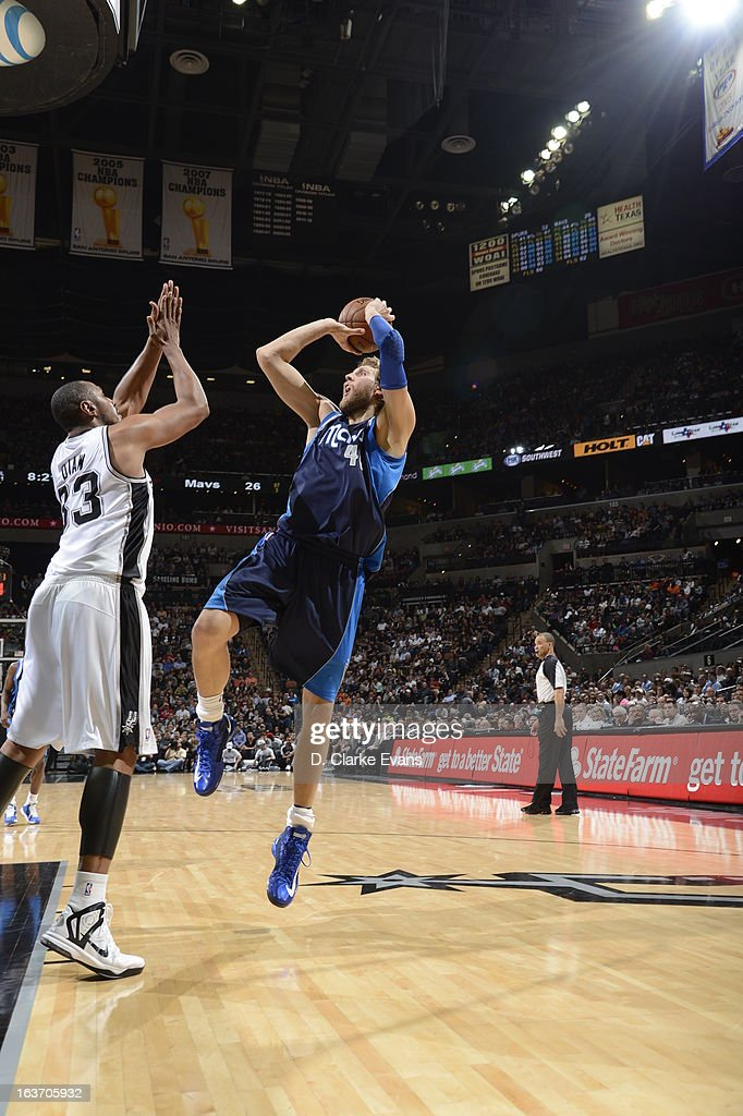 Dirk Nowitzki #41 of the Dallas Mavericks shoots a fade-away shot against Boris Diaw #33 of the San Antonio Spurs on March 14, 2013 at the AT&T Center in San Antonio, Texas.
