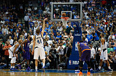 Dirk Nowitzki of the Dallas Mavericks shoots a free throw against the Phoenix Suns in the second half at American Airlines Center on April 8 2015 in...