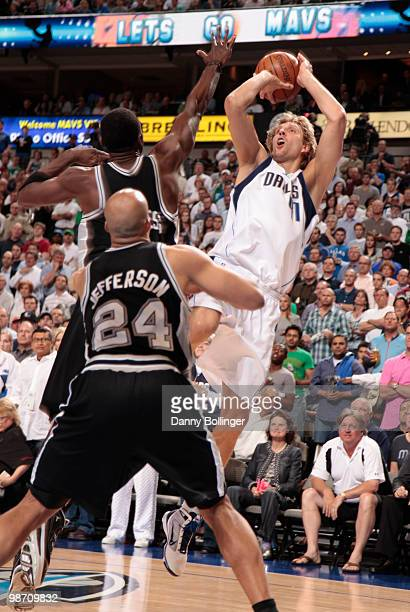 Dirk Nowitzki of the Dallas Mavericks shoots a jumper against Antonio McDyess and Richard Jefferson of the San Antonio Spurs in Game Five of the...