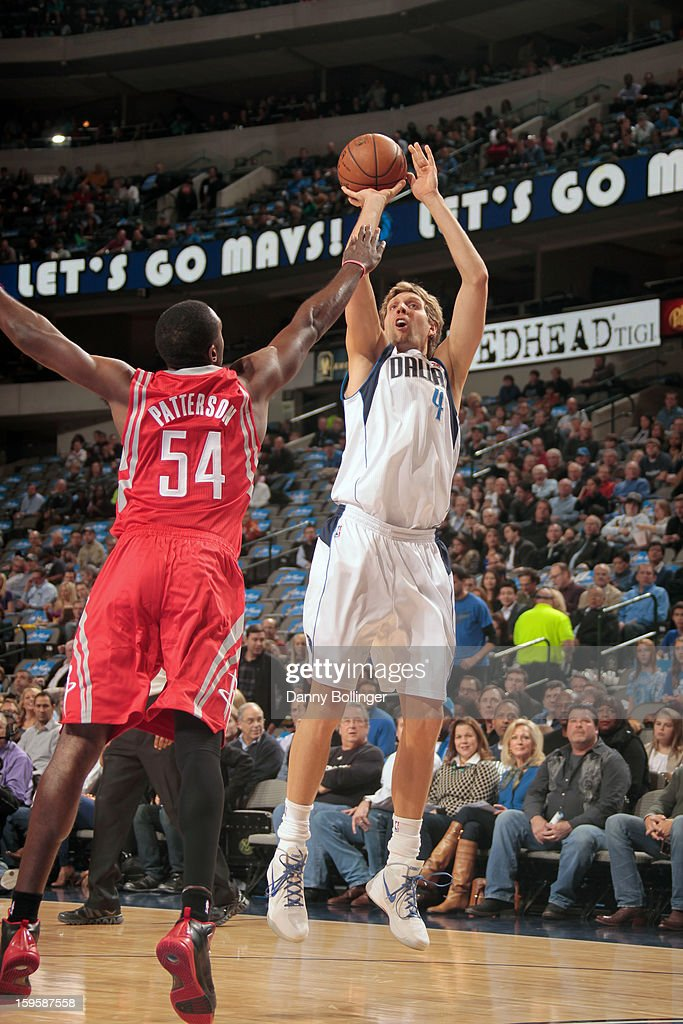 Dirk Nowitzki #41 of the Dallas Mavericks shoots a jumper against Patrick Patterson #54 of the Houston Rockets on January 16, 2013 at the American Airlines Center in Dallas, Texas.
