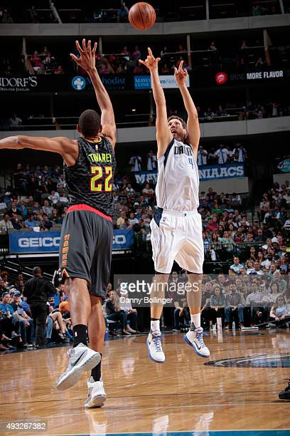 Dirk Nowitzki of the Dallas Mavericks shoots a jumper against Walter Tavares of the Atlanta Hawks on October 16 2015 at the American Airlines Center...