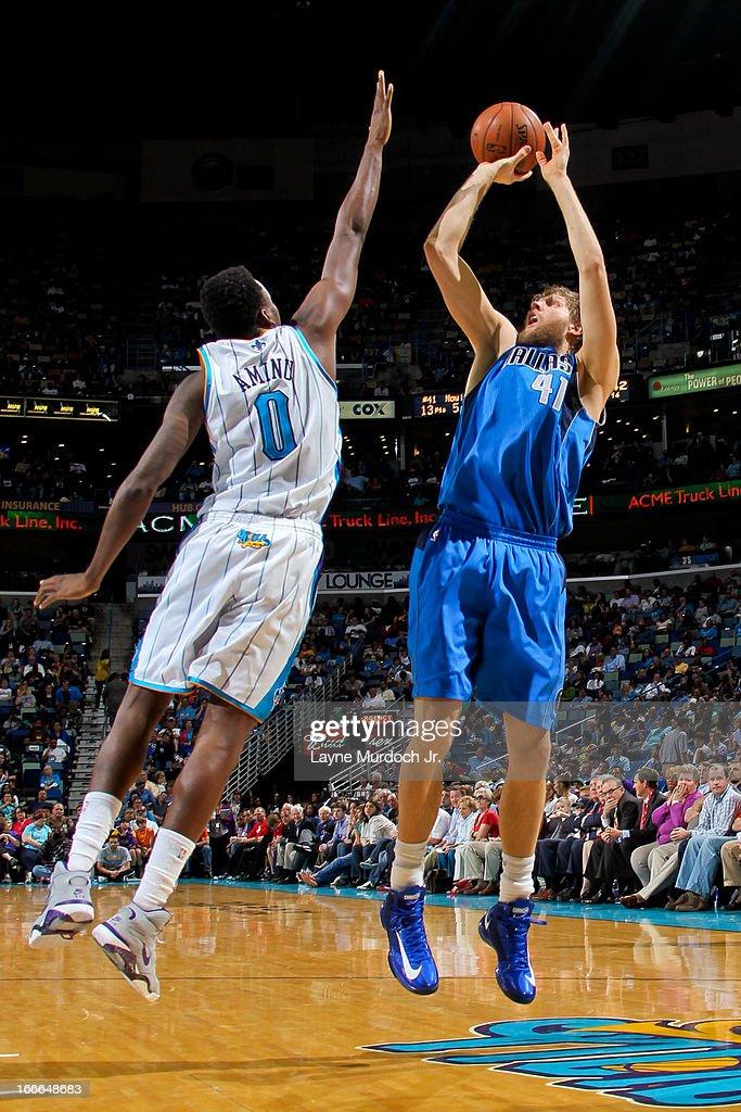 Dirk Nowitzki #41 of the Dallas Mavericks shoots against Al-Farouq Aminu #0 of the New Orleans Hornets on April 14, 2013 at the New Orleans Arena in New Orleans, Louisiana.