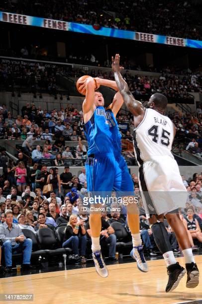 Dirk Nowitzki of the Dallas Mavericks shoots against DeJuan Blair of the San Antonio Spurs on March 23 2012 at the ATT Center in San Antonio Texas...