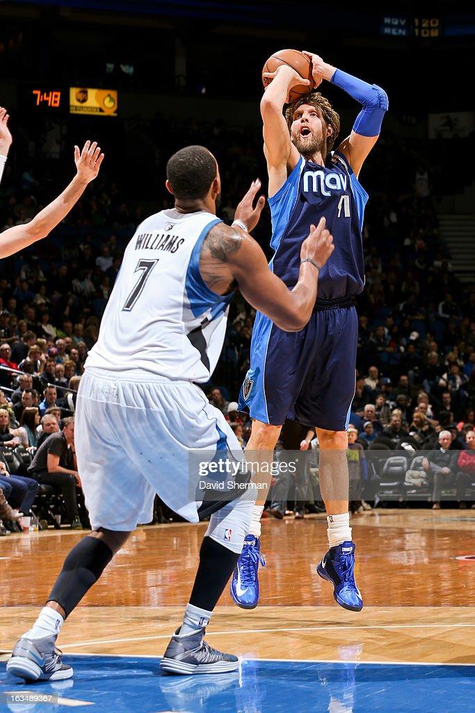 Dirk Nowitzki #41 of the Dallas Mavericks shoots against Derrick Williams #7 of the Minnesota Timberwolves on March 10, 2013 at Target Center in Minneapolis, Minnesota.