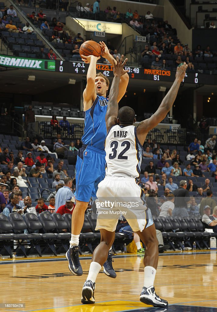<a gi-track='captionPersonalityLinkClicked' href=/galleries/search?phrase=Dirk+Nowitzki&family=editorial&specificpeople=201490 ng-click='$event.stopPropagation()'>Dirk Nowitzki</a> #41 of the Dallas Mavericks shoots against Ed Davis #32 of the Memphis Grizzlies during a game on October 9, 2013 at FedExForum in Memphis, Tennessee.