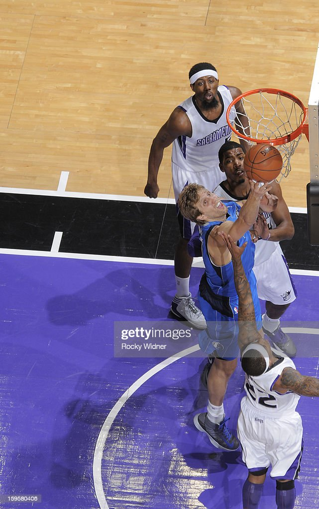 Dirk Nowitzki #41 of the Dallas Mavericks shoots against Isaiah Thomas #22 of the Sacramento Kings on January 10, 2013 at Sleep Train Arena in Sacramento, California.
