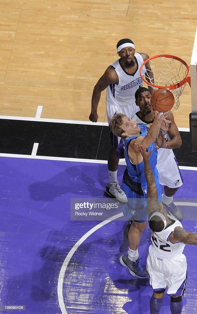 Dirk Nowitzki #41 of the Dallas Mavericks shoots against Isaiah Thomas #22 of the Sacramento Kings on January 10, 2013 at Sleep Train Arena in Sacramento, California.