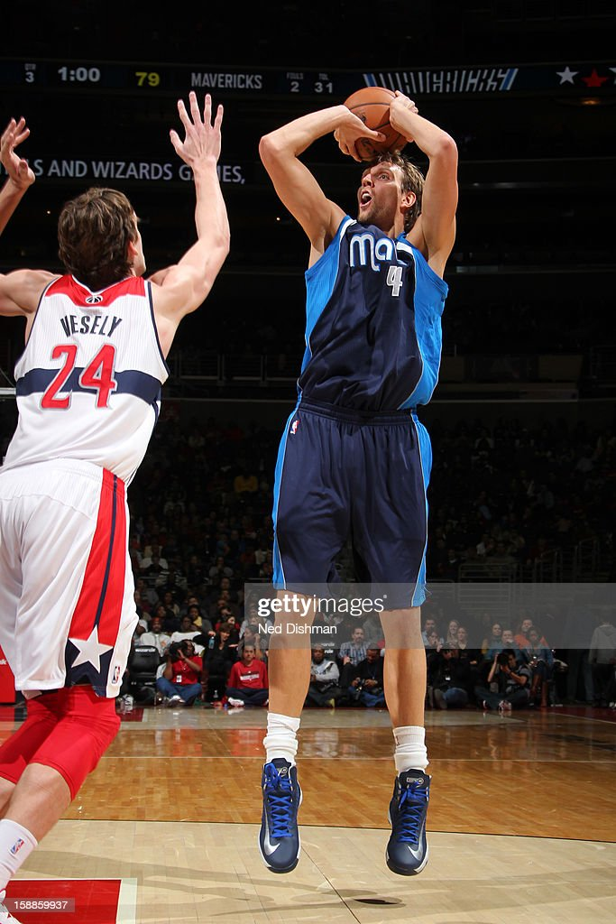 <a gi-track='captionPersonalityLinkClicked' href=/galleries/search?phrase=Dirk+Nowitzki&family=editorial&specificpeople=201490 ng-click='$event.stopPropagation()'>Dirk Nowitzki</a> #41 of the Dallas Mavericks shoots against <a gi-track='captionPersonalityLinkClicked' href=/galleries/search?phrase=Jan+Vesely&family=editorial&specificpeople=5620499 ng-click='$event.stopPropagation()'>Jan Vesely</a> #24 of the Washington Wizards during the game at the Verizon Center on January 1, 2013 in Washington, DC.