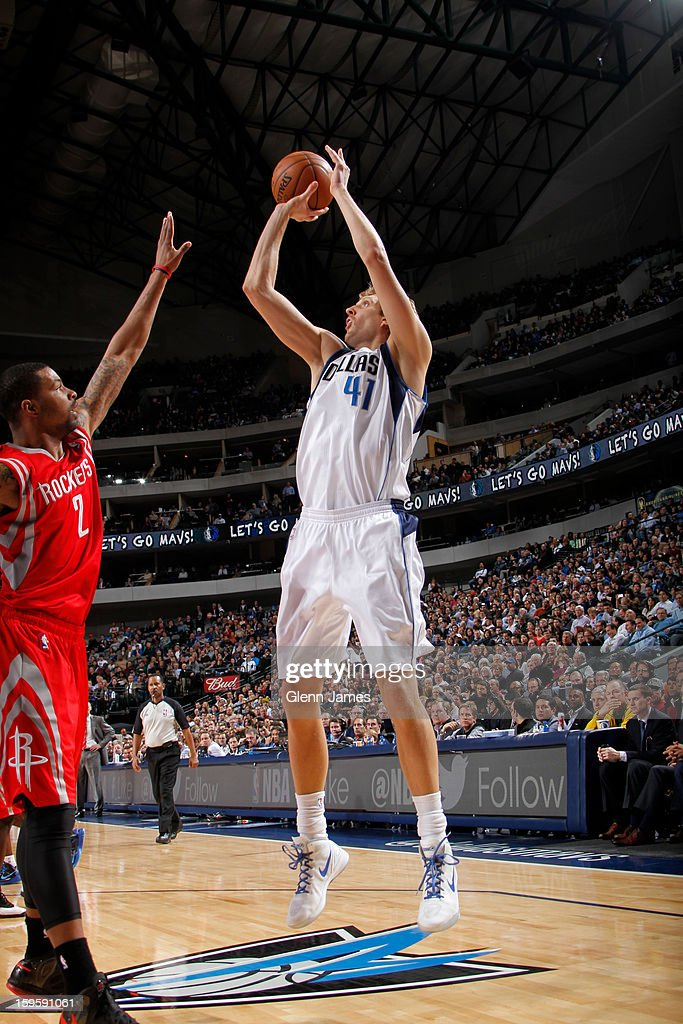Dirk Nowitzki #41 of the Dallas Mavericks shoots against Marcus Morris #2 of the Houston Rockets on January 16, 2013 at the American Airlines Center in Dallas, Texas.