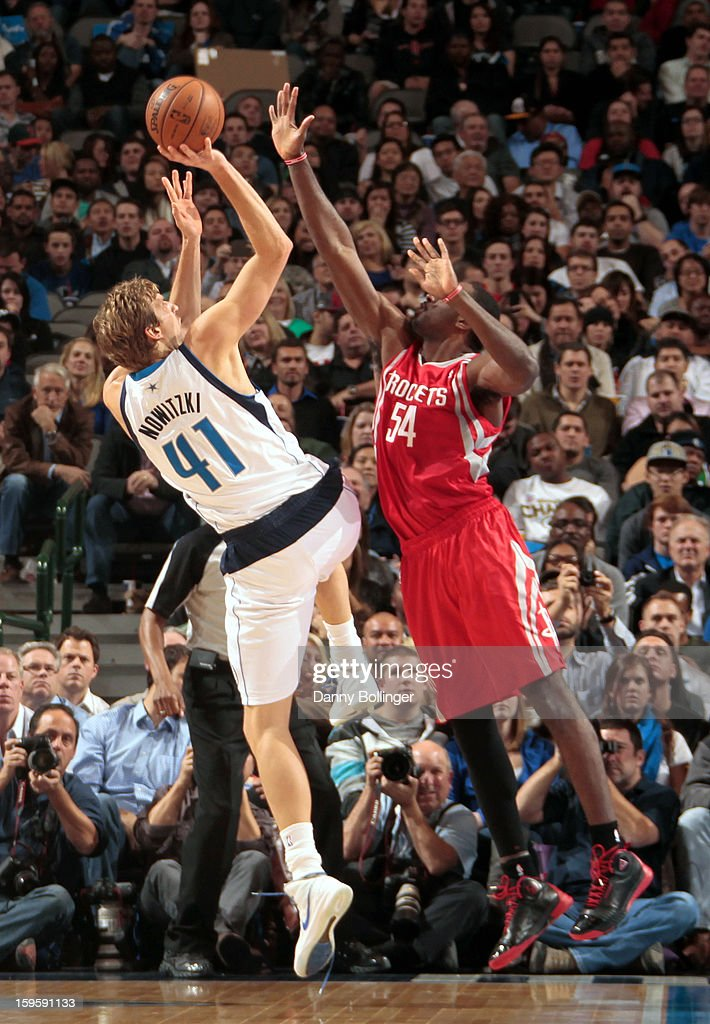 Dirk Nowitzki #41 of the Dallas Mavericks shoots against Patrick Patterson #54 of the Houston Rockets on January 16, 2013 at the American Airlines Center in Dallas, Texas.