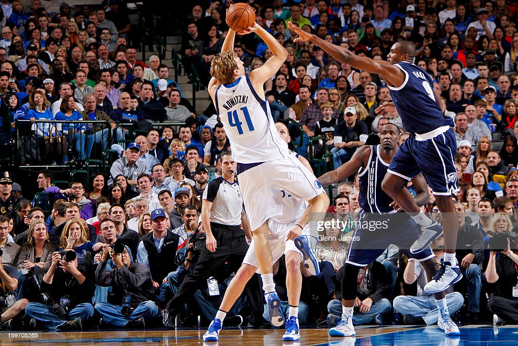 Dirk Nowitzki #41 of the Dallas Mavericks shoots against Serge Ibaka #9 of the Oklahoma City Thunder on January 18, 2013 at the American Airlines Center in Dallas, Texas.