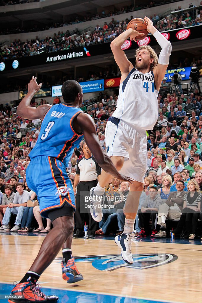 Dirk Nowitzki #41 of the Dallas Mavericks shoots against Serge Ibaka #9 of the Oklahoma City Thunder on March 17, 2013 at the American Airlines Center in Dallas, Texas.