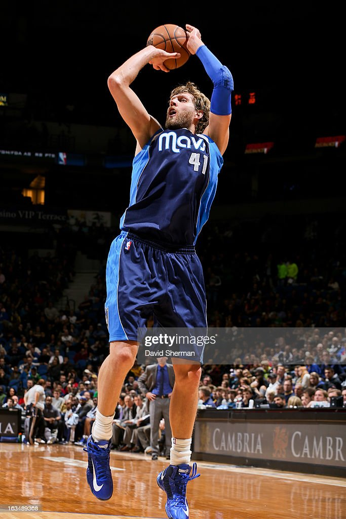 Dirk Nowitzki #41 of the Dallas Mavericks shoots against the Minnesota Timberwolves on March 10, 2013 at Target Center in Minneapolis, Minnesota.