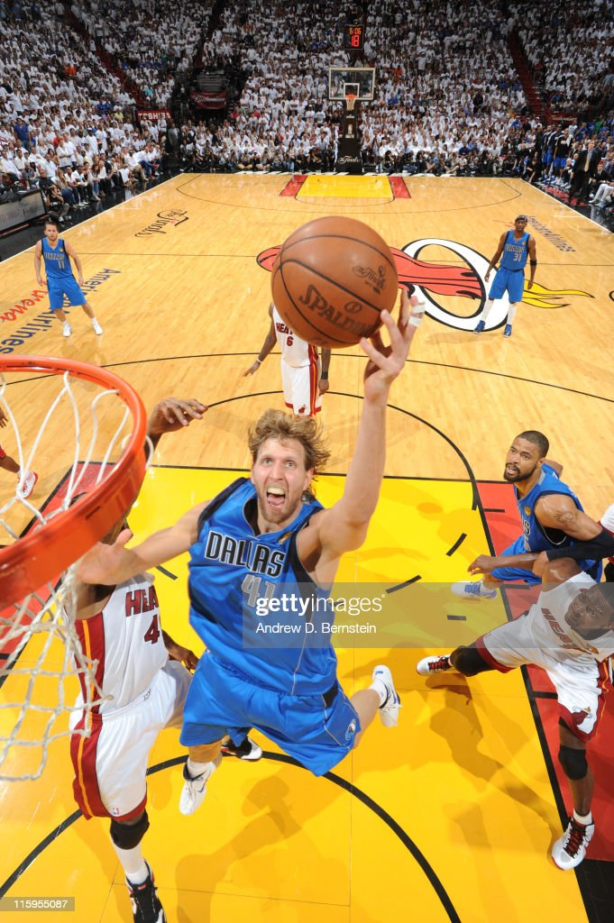 Dirk Nowitzki #41 of the Dallas Mavericks shoots against Udonis Haslem #40 of the Miami Heat during Game Six of the 2011 NBA Finals on June 12, 2011 at the American Airlines Arena in Miami, Florida.