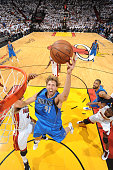 Dirk Nowitzki of the Dallas Mavericks shoots against Udonis Haslem of the Miami Heat during Game Six of the 2011 NBA Finals on June 12 2011 at the...