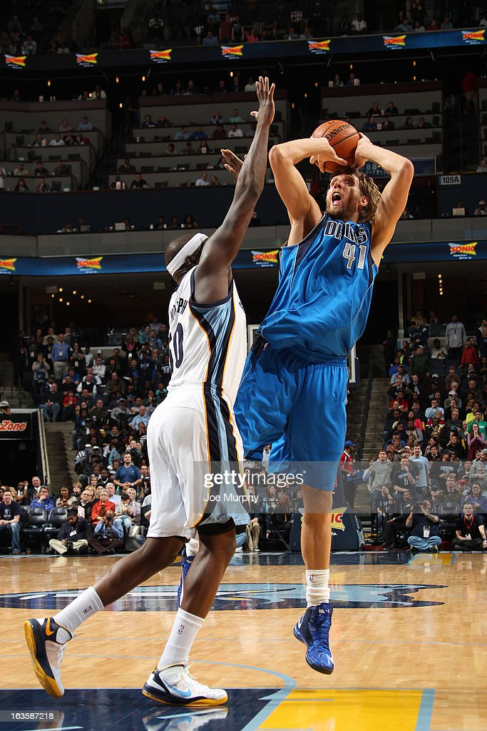<a gi-track='captionPersonalityLinkClicked' href=/galleries/search?phrase=Dirk+Nowitzki&family=editorial&specificpeople=201490 ng-click='$event.stopPropagation()'>Dirk Nowitzki</a> #41 of the Dallas Mavericks shoots against <a gi-track='captionPersonalityLinkClicked' href=/galleries/search?phrase=Zach+Randolph&family=editorial&specificpeople=201595 ng-click='$event.stopPropagation()'>Zach Randolph</a> #50 of the Memphis Grizzlies on February 27, 2013 at FedExForum in Memphis, Tennessee.