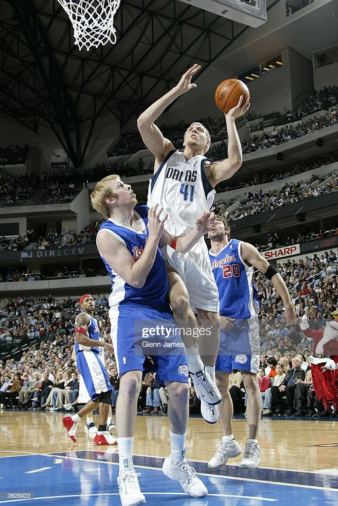Dirk Nowitzki of the Dallas Mavericks shoots in a game against the LA Clippers December 20 2003 at the American Airlines Center in Dallas Texas NOTE...